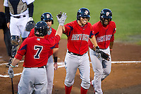 Pawtucket Red Sox third baseman Danny Valencia #36 is greeted by Andy LaRoche #7, flanked by J.C. Linares (behind LaRoche) and Tony Thomas (right) after hitting a three run home run during game four of a best of five playoff series against the Empire State Yankees at Frontier Field on September 8, 2012 in Rochester, New York.  Pawtucket defeated Empire State 7-1 to advance to the International League Finals.  (Mike Janes/Four Seam Images)