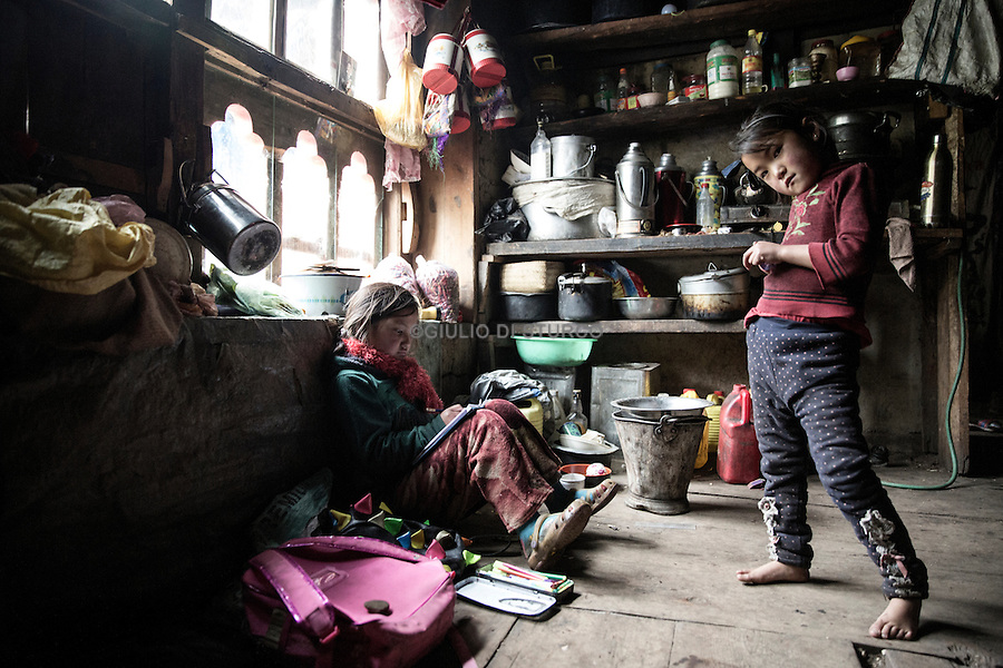 Sonam Dorji , 31 years with his daughters, they live in Dango Chang village at 4100 metri<br /> 28 Houses and 300 people live here. Jhomolhari, Bhutan June 2016