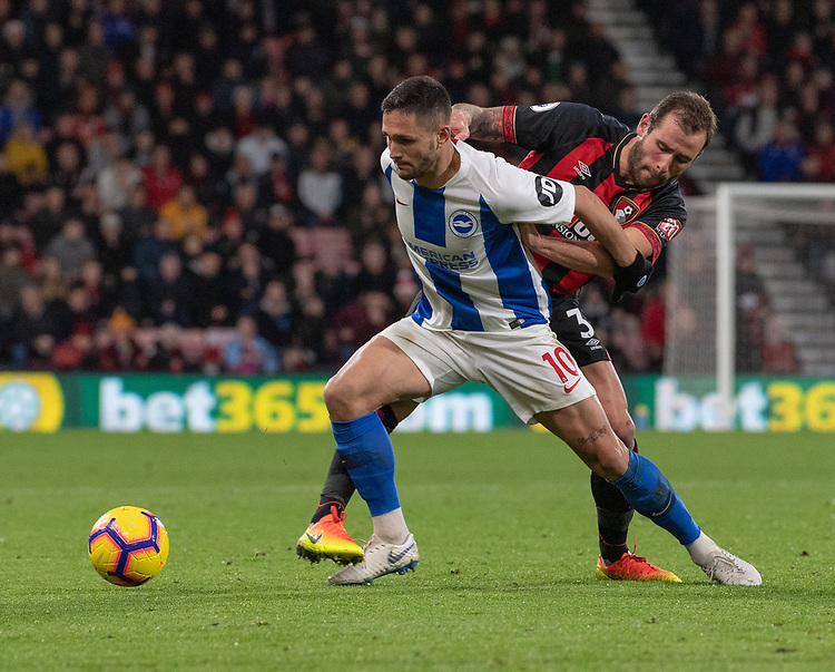 Bournemouth's Steve Cook (right)  vies for possession with  Brighton & Hove Albion's Florin Andone (left) <br /> <br /> Photographer David Horton/CameraSport<br /> <br /> The Premier League - Bournemouth v Brighton and Hove Albion - Saturday 22nd December 2018 - Vitality Stadium - Bournemouth<br /> <br /> World Copyright © 2018 CameraSport. All rights reserved. 43 Linden Ave. Countesthorpe. Leicester. England. LE8 5PG - Tel: +44 (0) 116 277 4147 - admin@camerasport.com - www.camerasport.com