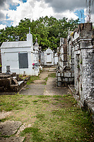 Lafayette Cemetery No. 1, 1420 Washington Avenue, established in 1833 by the City of Lafayette. The square was acquired from Cornelius Hurst and the cemetery laid out by Benjamin Buisson, city surveyor. Part of the Livaudais Plantation which had been subdivided into city squares in 1832. The cemetery contains many fine and historic tombs, among them those of Samuel Jarvis Peters, father of the New Orleans public school system, and General Harry T. Hays, distinguished confederate general. At Lafayette Cemetery No. 1 are buried many persons of German and Irish origin who lived in the City of Lafayette. The typical New Orleans burial vaults adjoining Washington Avenue were restored and magnolia trees on the cross aisle replanted by the City of New Orleans when Victor H. Schiro was mayor.