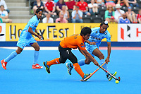 Fitri Saari of Malaysia wins the ball from Akashdeep Singh of India during the Hockey World League Quarter-Final match between India and Malaysia at the Olympic Park, London, England on 22 June 2017. Photo by Steve McCarthy.