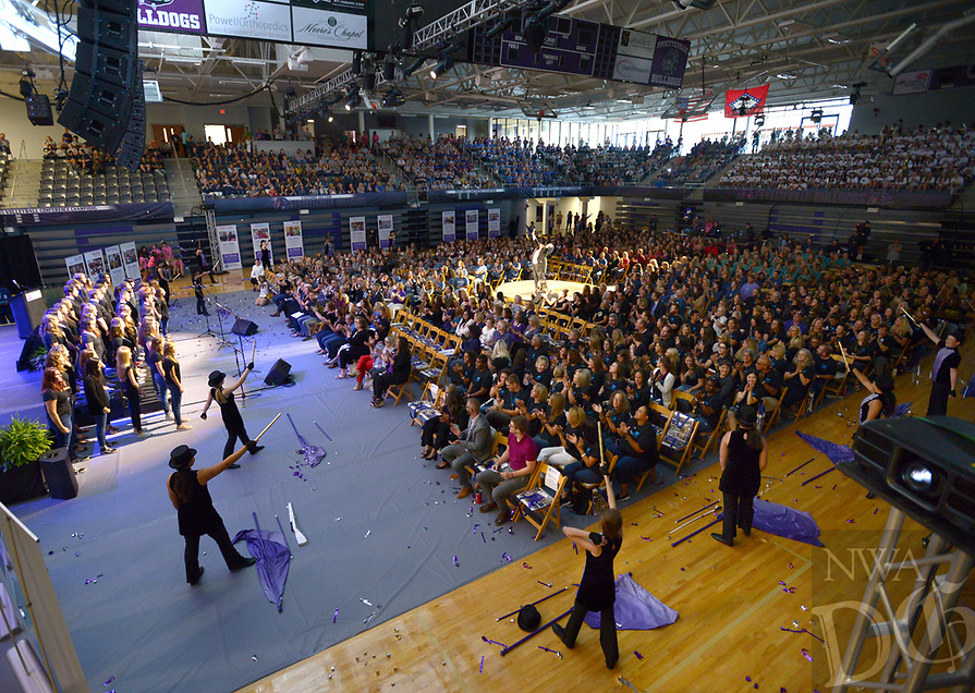 NWA Democrat-Gazette/ANDY SHUPE<br /> Teachers, administrators and staff of Fayetteville Public Schools watch Friday, Aug. 10, 2018, as students perform to open the Fayetteville Public Schools annual Convocation ceremony in Bulldog Arena on the Fayetteville High School campus. The event, which features performances by a combined choir and the high school band as well as awards and presentations, serves as a kickoff to the school year which begins Monday.
