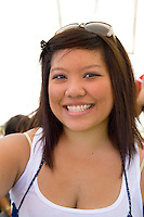 Attractive Hmong woman enjoying the festival events. Hmong Sports Festival McMurray Field St Paul Minnesota USA