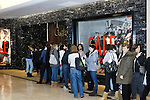 People lined up in front of a store in a shopping mall on a Boxing Day in Toronto, Canada.