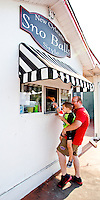 You can beat the heat in downtown Fort Walton Beach with a visit to the Sno Ball stand..COLIN HACKLEY PHOTO