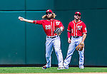 31 May 2014: Washington Nationals outfielder Jayson Werth makes a throw from right as Danny Espinosa watches during play against the Texas Rangers at Nationals Park in Washington, DC. The Nationals defeated the Rangers 10-2, notching a second win of their 3-game inter-league series. Mandatory Credit: Ed Wolfstein Photo *** RAW (NEF) Image File Available ***