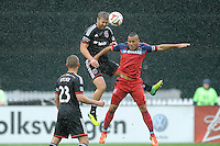 Washington, D.C.- March 29, 2014. Jeff Parke (2) of D.C. United heads the ball against Alex of the Chicago Fire. The Chicago Fire tied D.C. United 2-2 during a Major League Soccer Match for the 2014 season at RFK Stadium.