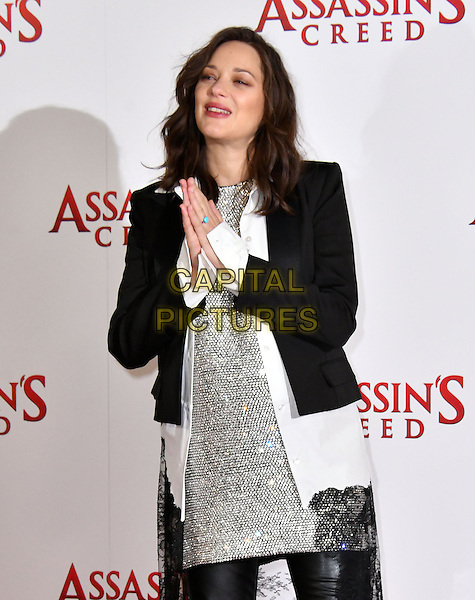 LONDON, ENGLAND - DECEMBER 08: Marion Cotillard attend the 'Assassin's Creed' photocall at Claridges Hotel on December 8, 2016 in London, England<br /> CAP/JOR<br /> &copy;JOR/Capital Pictures
