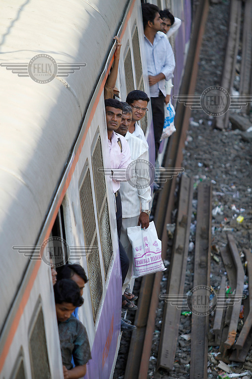 Commuters on a train in central Mumbai.
