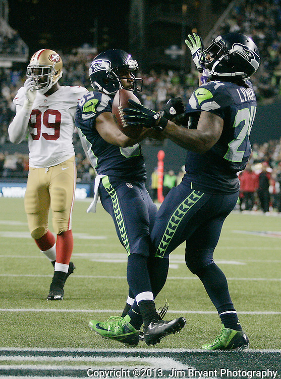 Seattle Seahawks wide receiver Doug Baldwin, left, celebrates with running back Marshawn Lynch after he scored on a 14-yard touchdown run against  San Francisco 49ers in the third quarter at CenturyLink Field in Seattle, Washington on September 15, 2013. Lynch finished with 135 total yards, including 98 yards rushing yards on 28 carries, scored three touchdowns in the Seattle Seahawks 29-3 win over the 49ers. The Seahawks beat the 49ers 29-3. ©2013. Jim Bryant Photo. ALL RIGHTS RESERVED.