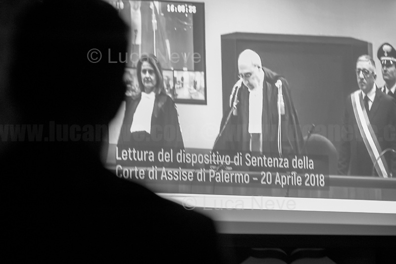 """Palermo, Sentence of condemnation for the """"mafia-State negotiation"""" trial (https://youtu.be/GEnI93fojh8).<br /> <br /> Rome, 08/02/19. Moby Dick Library & Antimafia Duemila(2.) held the presentation of the book """"Il Patto Sporco"""" (The Dirty Pact. The Trial State-mafia in the Story [narrated] by his Protagonist, Chiarelettere,1.) hosted by the author of the book Saverio Lodato (Journalist & Author), Nino Di Matteo (Protagonist of the book, Antimafia Magistrate of Palermo, member of the DNA - Antimafia & Antiterrorism National Directorate - who """"prosecuted the Italian State for conspiring with the Mafia in acts of murder & terror"""",3.4.5.6.) & Giorgio Bongiovanni (Editor of Antimafia Duemila). Chair of the event was Silvia Resta (Journalist & Author). Readers were: Bianca Nappi & Carlotta Natoli (both Actresses). From the back cover of the book: """"Let us ask ourselves why politics, institutions, culture, have needed the words of judges to finally begin to understand…A handful of magistrates and investigators have shown not to be afraid to prosecute the [Italian] State. Now others must do their part too"""" (Nino Di Matteo). """"In the pages of this book I wanted the magistrate, the man, the protagonist and the witness to speak about a trial destined to leave its mark"""" (Saverio Lodato). From the book online page: """"The attacks to Lima [politician], Falcone & Borsellino [Judges], the bombs in Milan, Florence, Rome, the murders of valiant police commissioners & officers of the carabinieri. The [Ita] State on its knees, its best men sacrificed. However, while the blood of the massacres was still running there were those who, precisely in the name of the State, dialogued and interacted with the enemy. The sentence of condemnation of Palermo [""""mafia-State negotiation"""" trial which is told in the book], against the opinion of many 'deniers', proved that the negotiation not only was there but did not avoid more blood. On the contrary, it provoked it""""(1.).<br /> Footnotes/links at 2nd & """