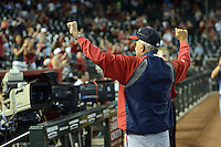 Washington Nationals manager Davey Johnson (5) acknowledges the fans as he manages his last game, announcing his retirement, against the Arizona Diamondbacks at Chase Field on September 29, 2013 in Phoenix, Arizona.  Arizona defeated Washington 3-2.  (Mike Janes/Four Seam Images)