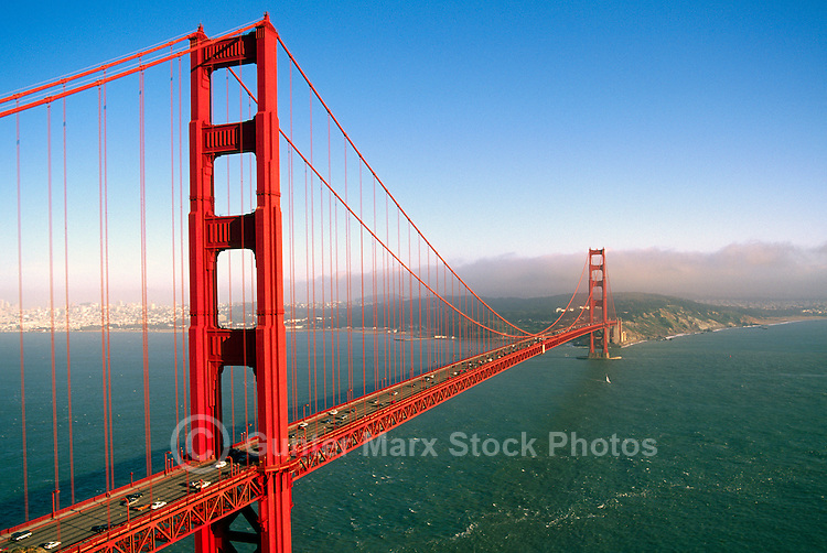 Golden Gate Bridge, San Francisco, California, USA - City Skyline in Distance across San Francisco Bay