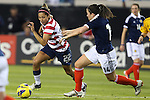 09 February 2012: Christen Press (USA) (22) and Leanne Crichton (SCO) (14). The United States Women's National Team played the Scotland Women's National Team at EverBank Field in Jacksonville, Florida in a women's international friendly soccer match. The U.S. won the game 4-1.