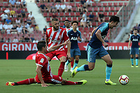 Son Heung-min of Tottenham evades a tackle during Girona FC vs Tottenham Hotspur, Friendly Match Football at Estadi Montilivi on 4th August 2018