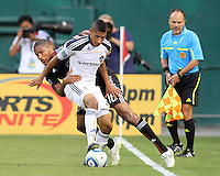 Jordan Graye #16 of D.C. United tangles with Sean Franklin #28 of the Los Angeles Galaxy during an MLS match at RFK Stadium on July 18 2010, in Washington D.C. Galaxy won 2-1.
