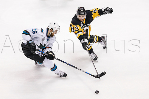 June 1, 2016:  San Jose Sharks center Nick Spaling (16) and Pittsburgh Penguins left wing Conor Sheary (43) fight for puck during the San Jose Sharks and Pittsburgh Penguins NHL Stanley Cup playoff game at Consol Energy Center in Pittsburgh, PA. Pittsburgh beat San Jose in overtime, 2-1.
