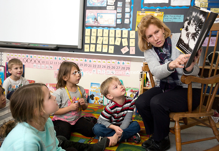 "Torrington, CT- 10 February 2016-021016CM10-  Phyllis Stearns, a media assistant, reads to kindergarten students  at Southwest Elementary School in Torrington on Wednesday.  Stearns was reading ""Good Night, Firefly"" by Gabriel Alborozo. The Northwest Connecticut Chamber of Commerce held it's 25th annual read aloud day at regional schools, which included the Southwest School. Christopher Massa Republican-American"