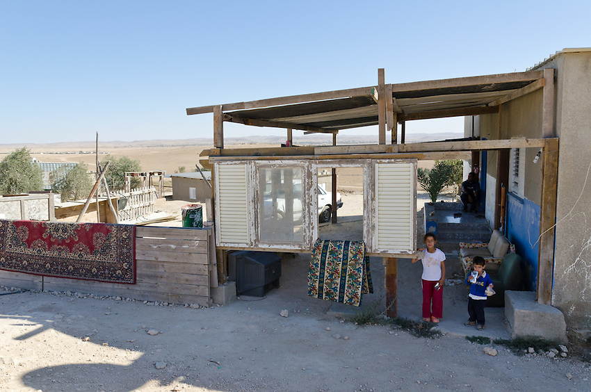 The kids of Mehar Elamor, outside their partially finished home in El Serah, an unrecognized Bedouin village in Israel's Negev desert. The home and the village are slated for demolition.