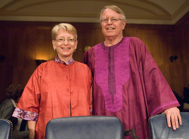 """Chuck Ludlam and Paula Hirschoff, Peace Corps volunteers for Senegal, pose by the witness table before the start of the Senate Foreign Relations Committee Western Hemisphere, Peace Corps, and Narcotics Affairs Subcommittee hearing on """"Enhancing The Peace Corps Experience: S.732, the 'Peace Corps Volunteer Empowerment Act'"""" on Wednesday, July 25, 2007."""