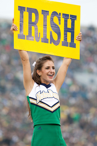 Notre Dame cheerleader perfroms during NCAA football game between the Notre Dame Fighting Irish and the Michigan Wolverines.  Michigan defeated Notre Dame 28-24 in game at Notre Dame Stadium in South Bend, Indiana.