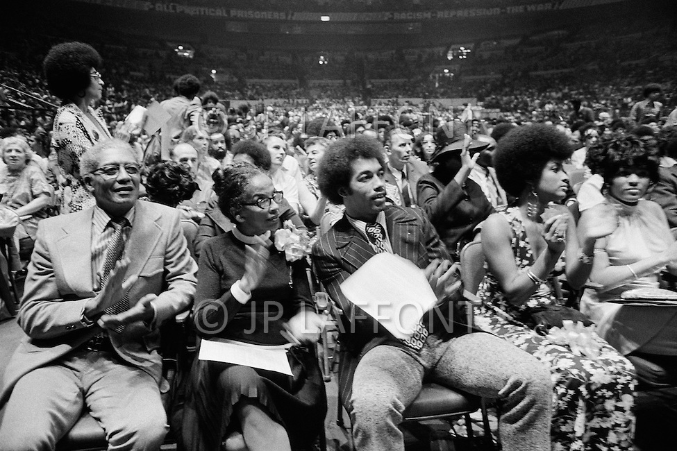 29 Jun 1972. Angela Davis' parents attending her meeting at the Madison Square Garden. She is protected during her speech by a four sided bullet proof shield.