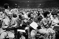 29 Jun 1972 --- Angela Davis' parents attending her meeting at the Madison Square Garden. She is protected during her speech by a four sided bullet proof shield. --- Image by © JP Laffont/Sygma/Corbis