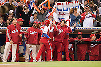 16 March 2009: #12 Michel Enriquez of Cuba is congratulated by teammates during the 2009 World Baseball Classic Pool 1 game 3 at Petco Park in San Diego, California, USA. Cuba wins 7-4 over Mexico.
