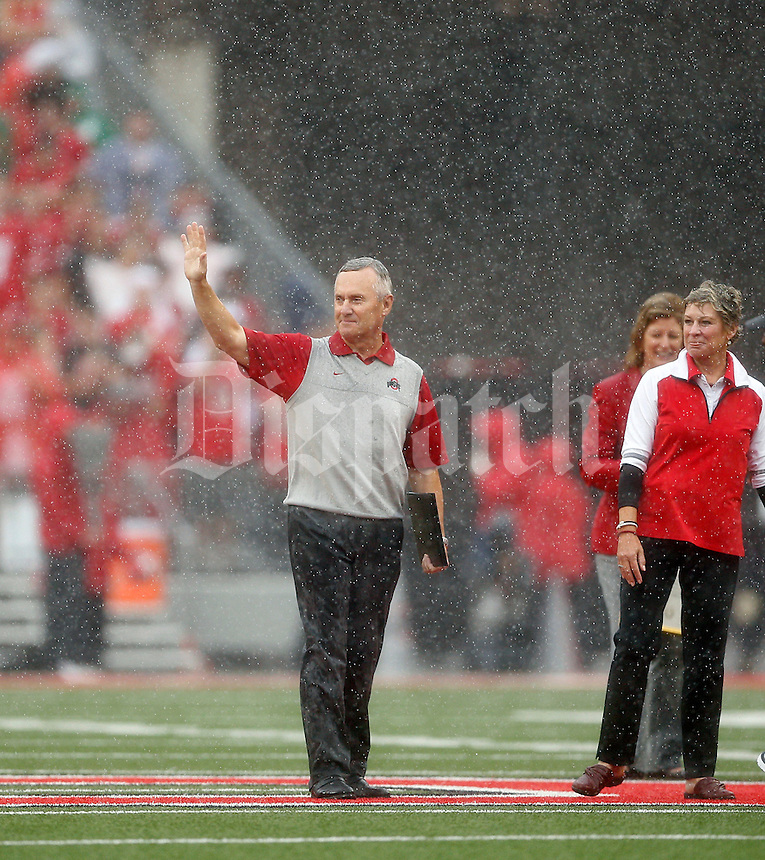 Former Ohio State Buckeyes Football coach Jim Tressel is honored during a timeout for the Ohio State Athletic Hall of Fame during the 1st quarter of their game at Ohio Stadium on September 19, 2015.  (Dispatch photo by Kyle Robertson)