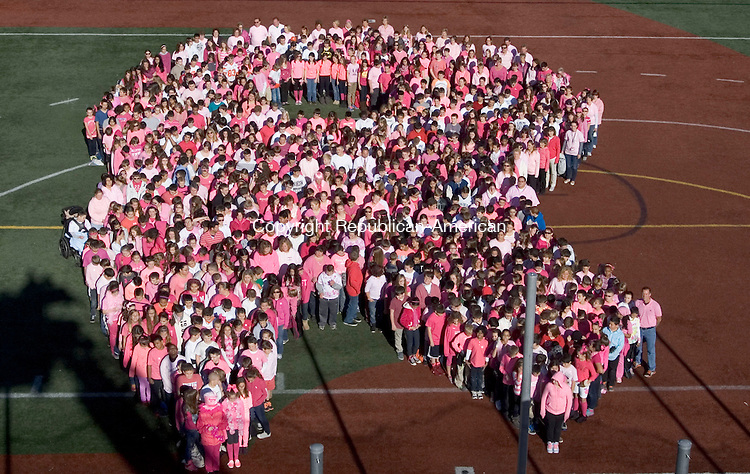 WATERTOWN CT. 25 October 2013-102513SV01-Swift Middle School students wore wear pink and white and formed a human ribbon in support of Assistant Principal Mary Jean Mangione, who was diagnosed with breast cancer in Watertown Friday.<br /> Steven Valenti Republican-American