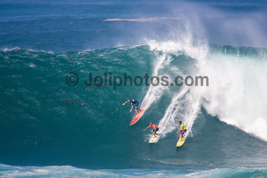 Waimea Bay, North Shore, Oahu, Hawaii December 15 2004.<br /> Ross Williams (HAW), Kelly Slater and Bruce Irons (Haw) - The 2004 Quiksilver Eddie Aikau Big Wave Invitational won by Hawaiian surfer Bruce Irons (HAW) from the island of Kauai was held in 30 to 40' waves at Waimea Bay on the North Shore of Oahu Hawaii, today, December 15th 2004. Irons rode one of the biggest waves of the day which was at least 30' in height, taking home US$55,000 in prize money.  Photo: Joliphotos.com