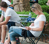 A with her iPad table computer in Bryant Park in New York on Thursday, June 7, 2012 (© Richard B. Levine)