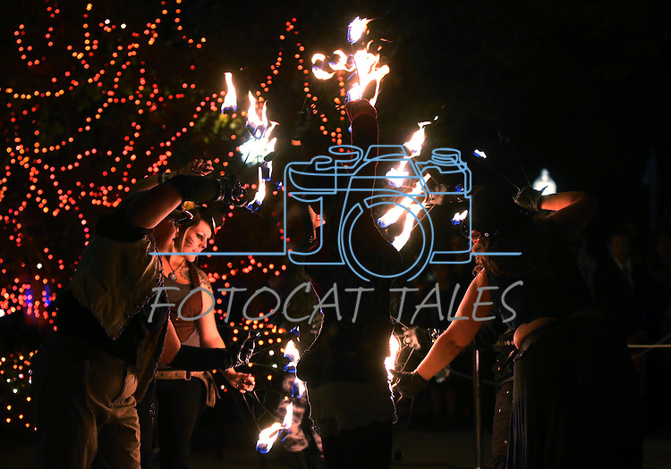 Controlled Burn fire dancers entertain the crowd during trick-or-treating at the Governor's Mansion, in Carson City, Nev., on Wednesday, Oct. 31, 2013.<br /> Photo by Cathleen Allison/Nevada Photo Source