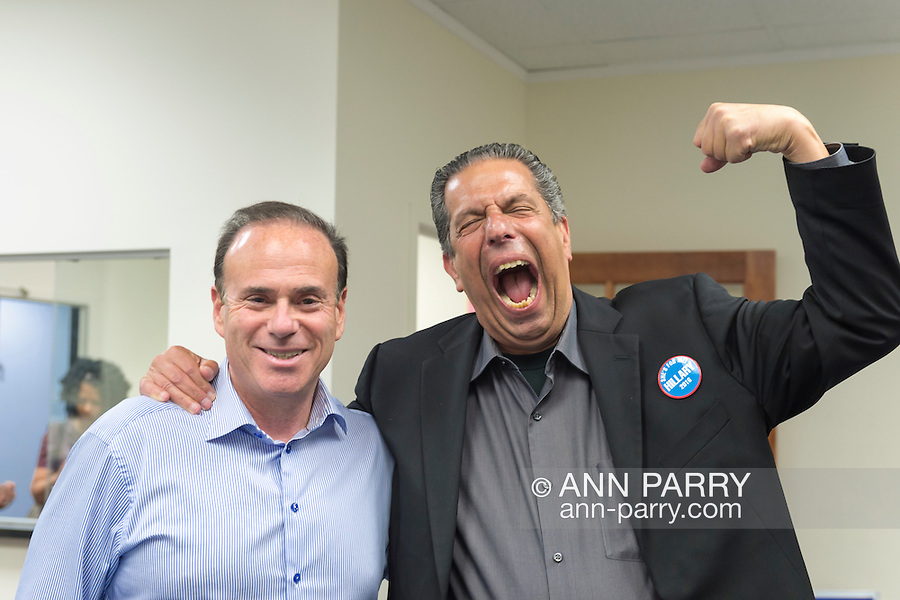 Garden City, New York, USA. 17th April 2016. R-L, JON BAUMAN, 'BOWZER', 69, singer in the band Sha Na Na, poses with JAY JACOBS, the Nassau County Democratic Chairman, at the Canvass Kickoff for Democratic presidential primary candidate Hillary Clinton at the Nassau County Democratic Office. In his Bowzer character's signature pose, Bauman lifted his arm and spoke in low voice. At the event, Bauman autographed photos of himself as Bowzer for the volunteers and spoke about why it's important to GOTV, Get Out The Vote for Hillary Clinton. Bauman is an activist in electoral politics and public policy activist and co-founded Senior Votes Count, which focuses on senior issues.