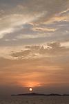 The sun setting in Raja Ampat, Raja Ampat, West Papua, Indonesia, Pacific Ocean