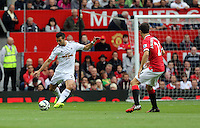 Pictured L-R: Jordi Amat of Swansea against Anderson of Manchester United. Saturday 16 August 2014<br />