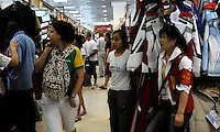 "Western customers at the Silk Market. The ""Silk Market"" in Central Beijing is proving a major tourist attraction with thousands of Olympic tourists flocking there daily in order to purchase fake designer goods ranging from clothing to watches.  The Beijing authorities closed hundreds of night-clubs and introduced many restriction on and rules ahead of the 2008 Olympics in the city mysteriously has allowed the trade of fake goods to foreigners continue, thumbing their nose at western companies.<br /> <br /> Photo by Richard Jones / sinopix"
