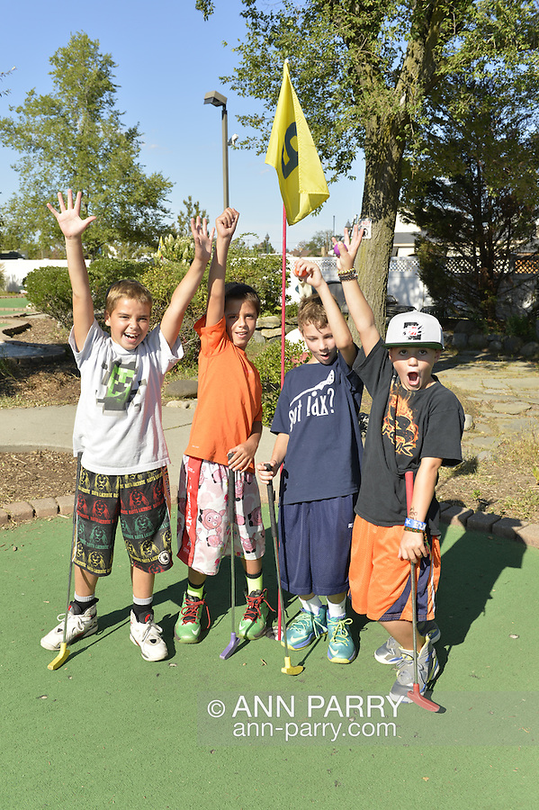 L-R, RYAN MACOLINO, 8; NATE Freeport, New York, U.S. September 6, 2013. MACOLINO, 8; DANNY TIMONEY, 8; and KEVIN MURRAY, 9, all from Bellmore, play miniature golf at Crow's Nest Mini Golf at the Nautical Mile.