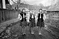 ROMANIA / Maramures / Valeni / April 2003..Village girls wearing traditional folk costume walk home after Easter Sunday festivities...© Davin Ellicson / Anzenberger..