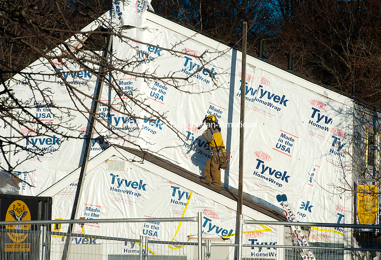 WATERBURY, CT--- -011316JS05--A worker makes his way up the side of one of the units being built as part of the $4.8 million renovation to the Frost Homestead on Mortimer Street in Waterbury on Wednesday. Construction began in October and is scheduled to be completed in August or September. <br />  Jim Shannon Republican-American
