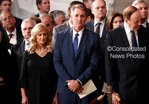 U.S. Senator Jeff Flake (R-AZ) arrives prior to ceremonies honoring late Senator John McCain inside the U.S. Capitol Rotunda in Washington, U.S., August 31, 2018. REUTERS/Kevin Lamarque
