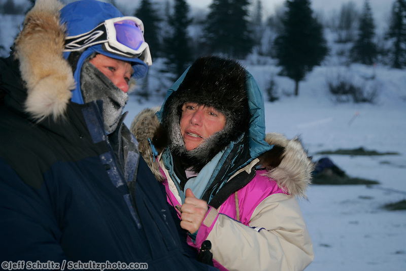 Tuesday March 6, 2007   Rainy Pass checkpoint----  Dee Dee Jonrowe talks with rookie Bruce Linton at the Rainy Pass checkpoint on Puntilla Lake at 20 below zero with 15-20 mph winds on Tuesday morning