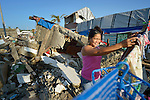 A woman hangs her laundry amid the rubble in Tacloban, a city in the Philippines province of Leyte that was hit hard by Typhoon Haiyan in November 2013. The storm was known locally as Yolanda. The ACT Alliance has been active here and in affected communities throughout the region helping survivors to rebuild their homes and recover their livelihoods.