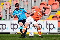 Fleetwood Town's George Glendon vies for possession with Blackpool's Jimmy Ryan<br /> <br /> Photographer Richard Martin-Roberts/CameraSport<br /> <br /> The EFL Sky Bet League One - Blackpool v Fleetwood Town - Saturday 14th April 2018 - Bloomfield Road - Blackpool<br /> <br /> World Copyright &not;&copy; 2018 CameraSport. All rights reserved. 43 Linden Ave. Countesthorpe. Leicester. England. LE8 5PG - Tel: +44 (0) 116 277 4147 - admin@camerasport.com - www.camerasport.com