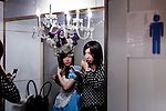 Tokyo, April 27 2013 - One girl (left) and a man dressed as a girl (right) in men's restorooms at Propaganda party in Tokyo. Once a month, around 300 people gather to celebrate men dressed as girls. Josou (???can be married men who wish to have a new experience by dressing as women.
