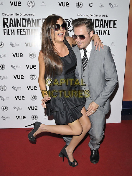 LONDON, ENGLAND - SEPTEMBER 30: Posh &amp; Becks lookalikes Camilla Shadbolt &amp; Andy Harmer  attend the &quot;United We Fall&quot; UK film premiere, Raindance film festival, Vue Piccadilly cinema, Lower Regent St., on Tuesday September 30, 2014 in London, England, UK. <br /> CAP/CAN<br /> &copy;Can Nguyen/Capital Pictures