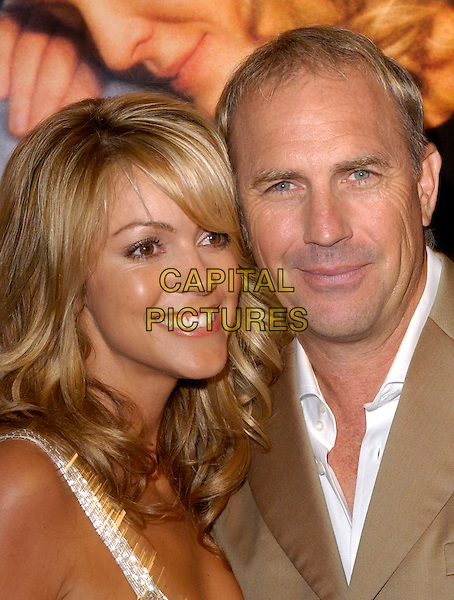 CHRISTINE BAUMGARTNER & KEVIN COSTNER.Attends New Line Cinema's World Premiere of Upside of Anger held at the Mann National Theatre in Westwood, California  .March 3rd 2005.headshot portrait married couple husband wife .www.capitalpictures.com.sales@capitalpictures.com.Supplied By Capital PIctures