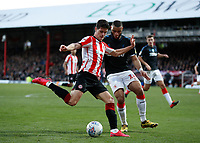 8th February 2020; Griffin Park, London, England; English Championship Football, Brentford FC versus Middlesbrough; Christian Norgaard of Brentford crosses the ball with Harold Moukoudi of Middlesbrough marking