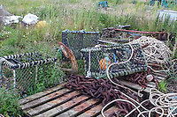 Lobster pots, rusting chain, ropes and anchor, Holy Island beach