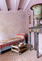 In the rose-pink salon an outsize Medici bronze urn takes pride of place on top of an antique console table